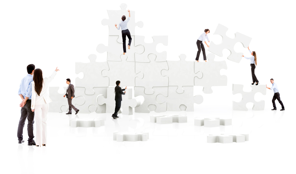Business teamwork in action - isolated over white