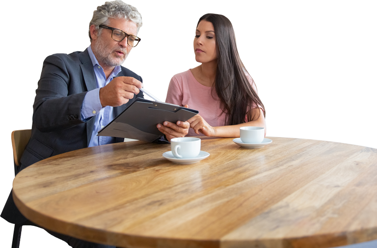 Man holding tablet and talking to woman sitting next to him