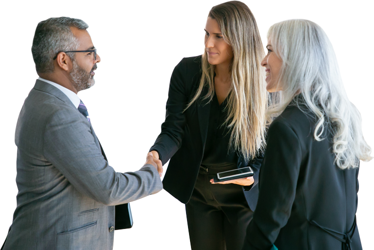 Woman and man shaking hand with another woman next to them