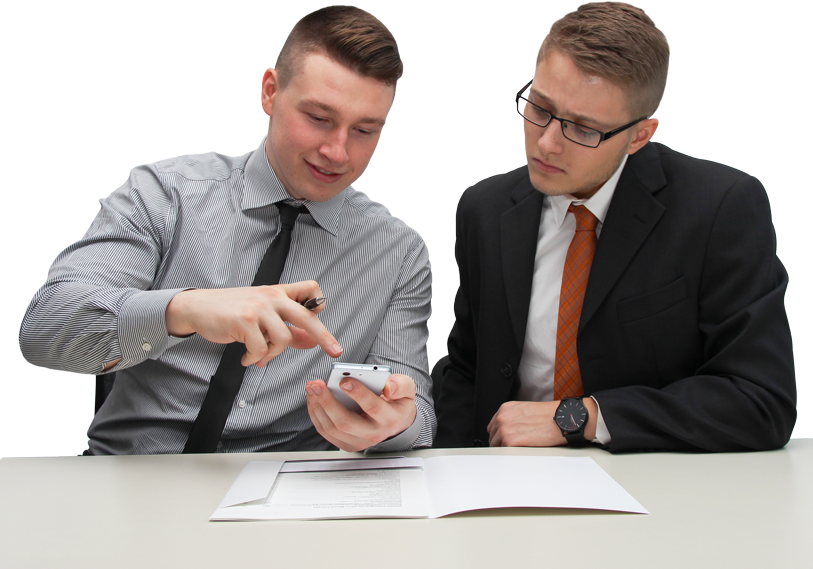 Two men calculating numbers with book open