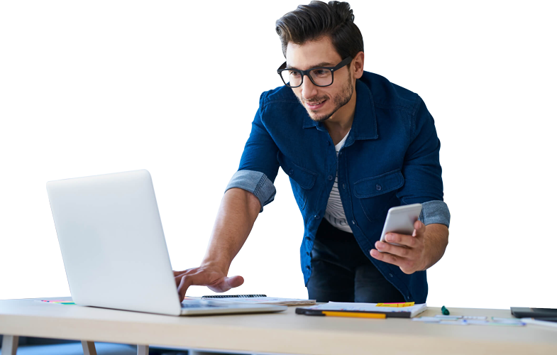 Man working on phone and laptop together