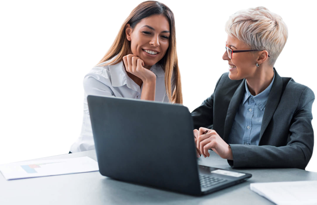 Two women collaborating around a laptop